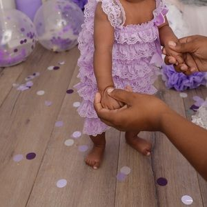 Baby lace romper worn for pictures